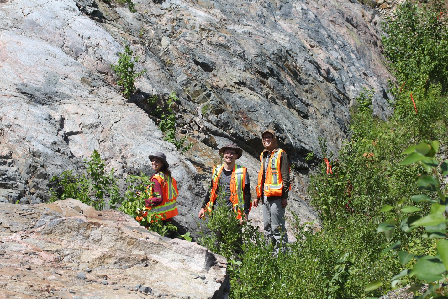 Sandra Baurier Aymat, Henning Seibel, and Dustin Peters in the field in Sudbury (photo by M Lesher)