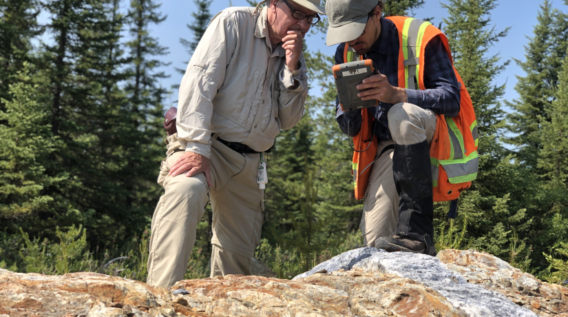 Université du Québec à Chicoutimi Professor Real Daigneault with Adrien Boucher, M.Sc. candidate, conducting fieldwork for the Metal Earth program in Abitibi in 2019. Photo credit: Mineral Exploration Research Centre.