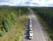 Metal Earth project enters 4th field season - photo of trucks on road.